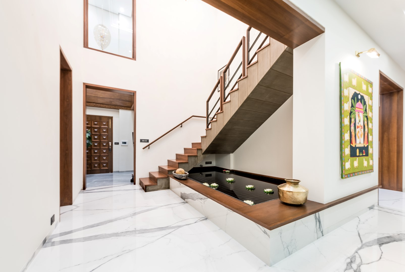 luxurious penthouse interior design is a showcase of the bond in combination with the sleek glass wood and m s railing the exposed concrete staircase glides above the water body which with a peripheral seat around