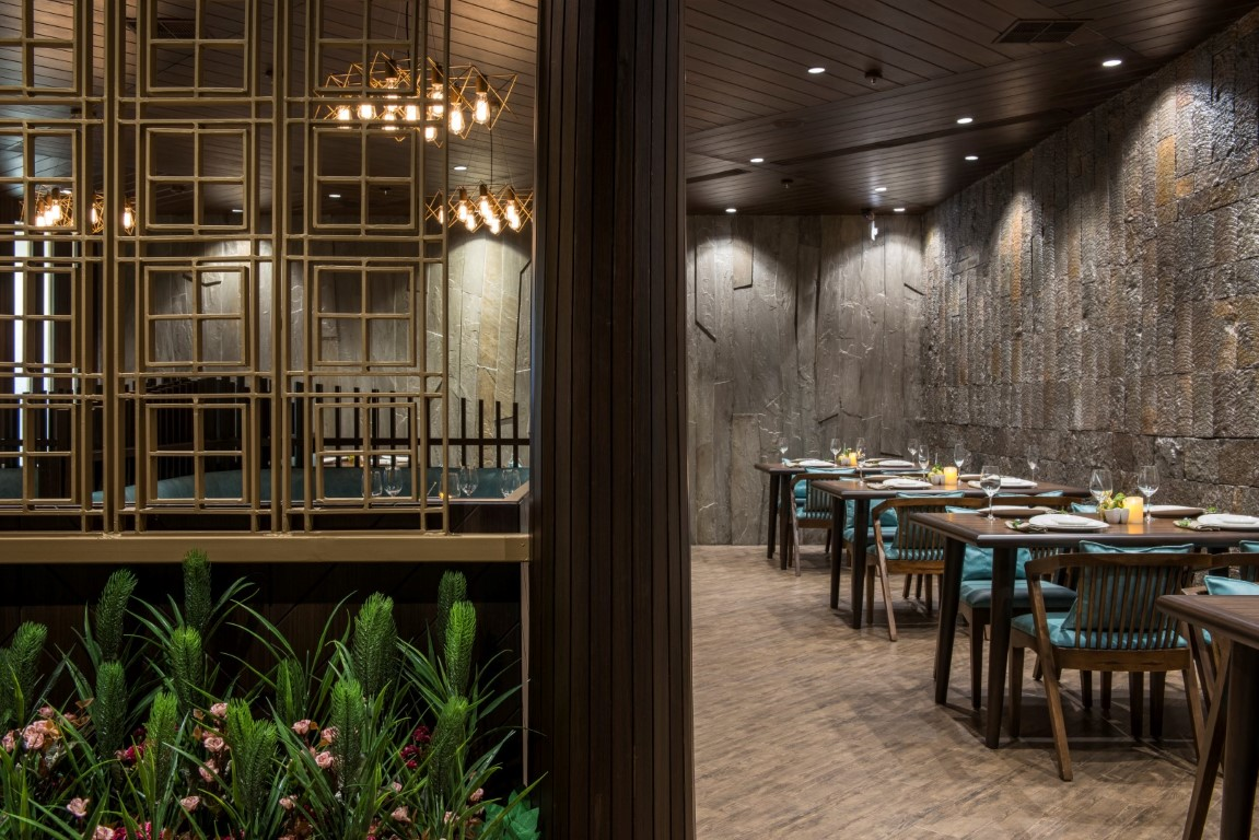 Vintage looking restaurant design has modern experience for Wooden hotel design
