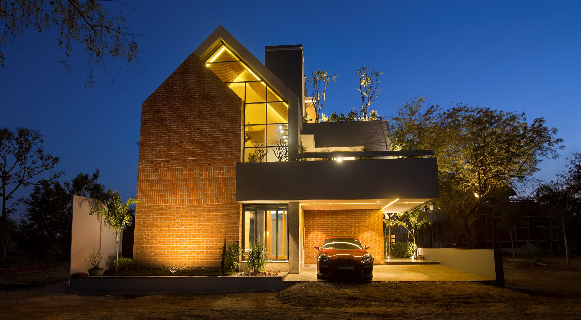 Brick Front Elevation Designs : An exposed brick front elevation gives the villa