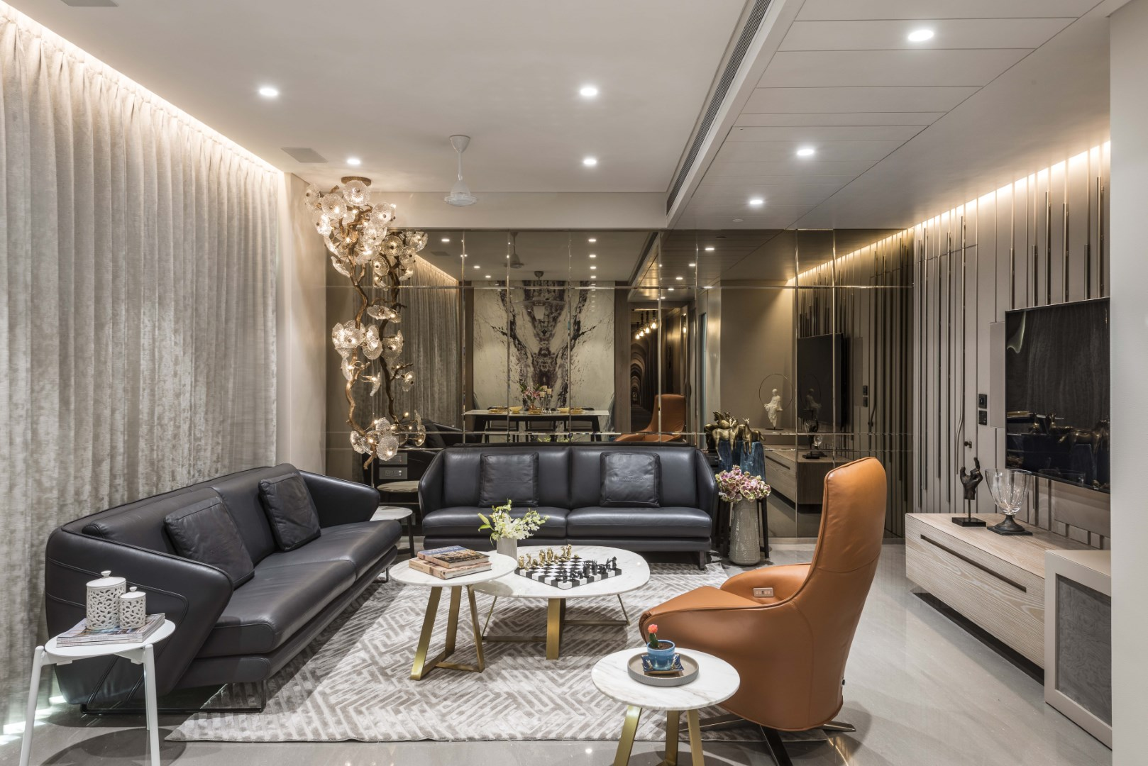 An aura of class and modern elegance permeates every nook of this beautiful and functional apartment the living room opening to terrace and the bar counter